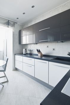 Grey and white gloss kitchen - by BoConcept Designers. Bar area!