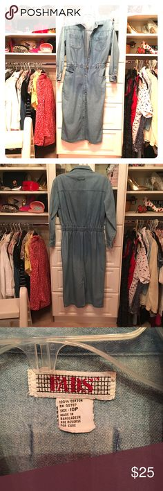 Vintage 100% cotton dress szM Beautiful 100% cotton vintage denim button down dress with the elastic on the back. It has shoulder pads that can be removed if you want and pockets. It is in very good condition. Very tech high quality denim. Hundred percent cotton and they don't make them like this anymore. Tag says 10 petite but it fits more like a medium size 4/6 could probably even do size 8 since it has elastic Dresses Midi
