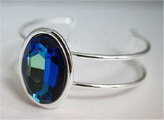 30x22mm Faceted Swarovski Crystal Oval Set in an Adjustable Bracelet Cuff