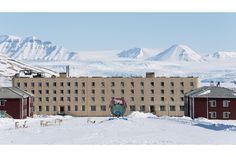 Ghost Town Pyramiden, Svalbard Island, Norway (Reindeer graze with Nordendkioldbreen Glacier in the background). Founded by Sweden in 1910 and sold to the Soviet Union in 1927, closed in 1998. Pyramiden is a Russian settlement; was a coal mining community on the archipelago of Svalbard, Norway; remained largely abandoned with most of its infrastructure and buildings still in place | by Christian Åslund
