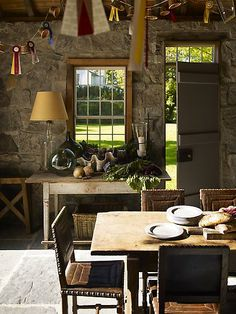 Keebler Elves! Am I wrong? I love this rustic country look... almost looks like a kitchen in a tree house ;)