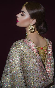 This bridal lehenga is featured in gold brocase shirt with zardozi hand embroidery all over it. Lehenga skirt is in purple colour with embroidered with zardozi work. Dupatta is in white colour with heavy embroidery all over. This lehenga set can wear in 3 styles 1. In full set same as displayed on model 2. Top with pant ( pant comes complementary) 3. Lehenga Skirt with Blouse of your Choice This bridal lehenga set can be customised in any color of your choice and we would require minimum 3…