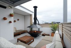 Rooftop terrace l Hanging pots l Large modern fire pit l Bench seating #stylecurator #theblock