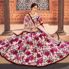 This pretty piece is a fairy tale that begins to unfold as you reveal your beauty in it. Add a vibrant burst of color to your wardrobe with this rose pink color taffeta silk designer lehenga choli. Look ravishing clad in this attire which is enhanced with print work.