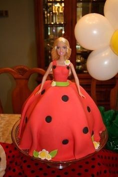 Lady bug Barbie cake