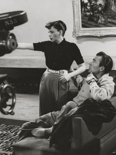 Judy Garland and James Mason discuss a scene on the set of A Star is Born, 1954