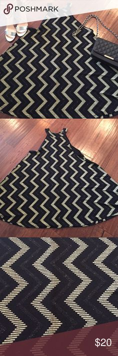 Gorgeous, flowy dress from local boutique, large Gorgeous flowy dress that is fitted up too and comfy and roomy on the bottom.  Black sparkly and cream chevron.  Size large.  Worn twice so I'm excellent condition.  Accessories not included. Dresses