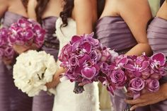 Cute, but instead, Bride with purple flowers and bridesmaids with white...