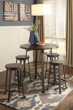 The Challiman 36 Counter Height Table 4 Stools Signature Design