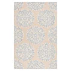 Hand-tufted rug with a scrolling medallion motif.    Product: RugConstruction Material: 100% Polyester