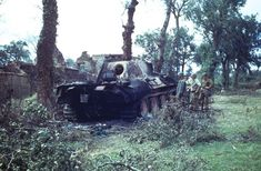 A group of American soldiers examine a ruined tank in the wake of the D-Day invasion by Allied forces during World War II, northern France, Get premium, high resolution news photos at Getty Images D Day Invasion, Ww2 Tanks, American Soldiers, Life Pictures, World War Two, Military Vehicles, Wwii, Panthers, Colour
