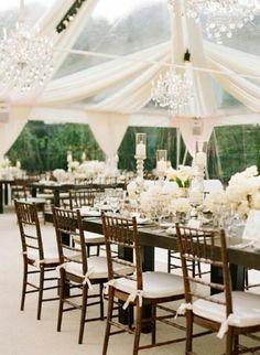 Outdoor elegant wedding marquee. Dark wood and cream