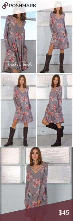 Floral Criss Cross Dress Gorgeous floral and grey criss cross V neckline. Long sleeve and 2 hidden pockets Made of a high quality rayon/spandex blend size S, M, L, XL Threads & Trends Dresses