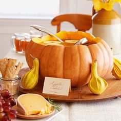 If you hollow out a pumpkin and use it as a punch bowl, you'll have one less dish to wash at the end of the night — and your Halloween party guests will be super impressed by your festive decor. Click through for more Halloween party ideas. Halloween Chic, Table Halloween, Cheap Halloween Decorations, Halloween Snacks, Holidays Halloween, Halloween Party, Haunted Halloween, House Decorations, Halloween Inspo