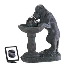 """Whimsical faux-bronze fountain depicts a parched pooch lapping up a refreshing cool drink of water. Solar power lets you place this adorable accent anywhere because no plugs are required! Resin. 21 7/8"""" x 13 3/4"""" x 27 1/8"""" high. Solar panel, pump and electrical adapter included. UL Recognized. (Regularly $249.95) SALE!"""