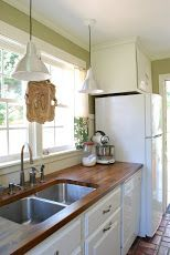 this & that: Kitchen.  The countertop is just butcher block countertop from ikea that they stained!  Super cheap too.  Love!