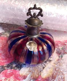 """LOVELY LITTLE PERFUME BOTTLE, HANDBLOWN & FUSED COLORED RED/NAVY/GOLD ZANFIRICO GLASS, 800 SILVER NECK & THREADED STOPPER. MURANO, ITALY. 20th C. This lovely small perfumiere shows off generations of art: a delicate 3"""" diameter glass ribbed melon is blown from fused ruby red, deep navy blue and powdery yellow gold """"zanfirico"""" bands.   eBay!"""