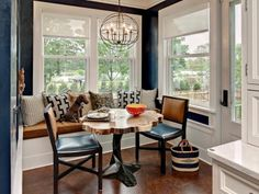 Here, interior designer Karen Soojian, ASID, supplemented banquette seating with two easily movable chairs, leaving room for traffic in and out of the kitchen door. In a tight space, portability is a plus — and so are eye-catching design elements. The table here was made of reclaimed wood from a felled tree found near this Minnesota home while the sculptural base was created by furniture designer Tristan Thiel.