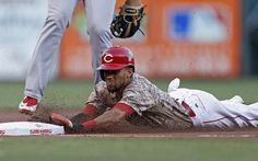 The Cincinnati Reds' Billy Hamilton is safe at third with a stolen base against the St. Louis Cardinals during the first inning of a baseball game, Friday, Sept. 2, 2016, in Cincinnati.