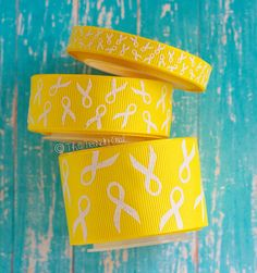 White Glitter Awareness Ribbons on Yellow  by TrendyOwlSupply