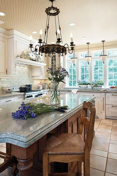 Island stone surface  & Celing detail. French country kitchen white with wood and granite