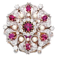 PLATINUM, GOLD, RUBY, DIAMOND AND PEARL BROOCH, PICKSLAY & CO. The stylized…