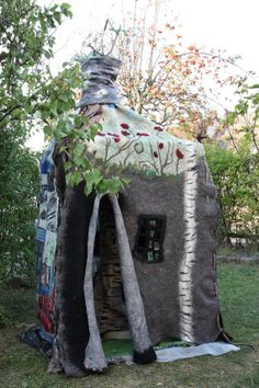 Um, yes... it IS a felted wool playhouse. Féerique sculpture d'art textile panneau by ArianeMariane on Etsy, €8500.00