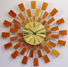 Mid century  Starburst Clock by Seth Thomas. Mid century Modern Sunburst clock, 1960s Grandeur Wall Clock.  After George Nelson Pixel Design. $310.00, via Etsy.