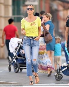 13acbb698ae Lovely in lemon  Heidi Klum looked lovely in a yellow top and jeans as she  made NYC into her stunning runway on Monday