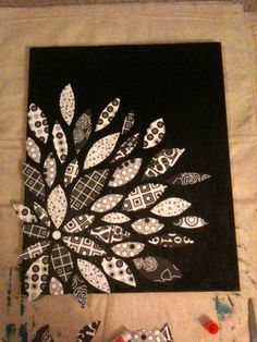 I found a really cool looking flower picture on Pinterest, and decided I wanted to create my own version. All I did was get a canvas, which I had some left over canvas from when I took some paintin...