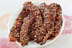 Nutty Brown Sugar Bacon recipe - As if bacon weren't already one of life's most profound pleasures, this recipe adds nutty and spicy to the mix with brown sugar, Dijon mustard and pecans.