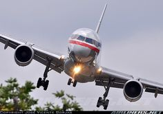 Boeing 757-223 banking slightly left to line up with the runway on landing