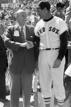 1960 Ted Williams shakes hands with Ty Cobb prior to a spring training game