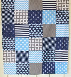 A lovely patchwork baby blanket, just like my Grandmother used to make.  This adorable blanket is perfect for that special little boy in your life. Navy blue, medium blue and steel gray anchors, whales, dots and chevron zig-zags cover the front of this sweet blanket. ~ Measures approximately 30 x 36 inches (2 foot 6 inches x 3 foot) or 36 x 42 inches (3 foot x 3 foot 6 inches). Great for swaddling, play time, a stroller quilt or big enough for a toddler to enjoy!  ~ The front is beautiful…