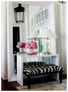 Bright entryway- feminine and edgy http://nomadluxuries.com/zebra-ottomans/