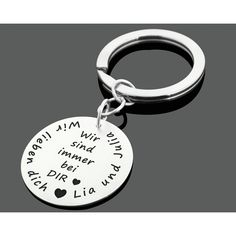 Ein personalisierter Schlüsselanhänger aus 925 Sterling Silber. Besonderes Geschenk für Papa oder Mama.