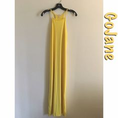 Yellow fitted maxi dress Capella Apparel fitted maxi dress from GoJane. Size: large. It is fitted, not a flowy maxi (keep in mind). Note: It will cling to any shape you have. Color: Yellow. Retailer: GoJane. 87% Polyester and 13% Spandex. Best to hand wash or put on delicates. Perfect for summer, if you're looking for a clingy maxi dress to show your curves (example in photo 4). GoJane Dresses Maxi