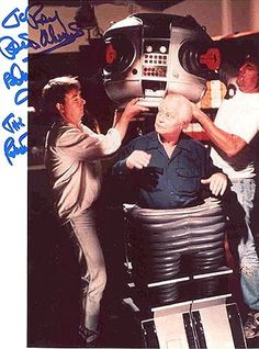 """Actor/operator Bob May, operating the robot from LOST IN SPACE in the """"Bermuda-shorts"""" configuration Space Tv Series, Space Tv Shows, Photo Vintage, Vintage Tv, Sci Fi Tv, Sci Fi Movies, Lost In Space Cast, Classic Sci Fi, Old Tv Shows"""