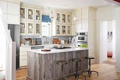 Love the barn wood wrapped kitchen island