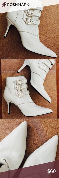 Sigerson Morrison white booties Sz7.5 White booties w/ hidden zipper under 3 buckles. White booties are very on trend rt now! Sigerson Morrison is such a luxurious line! These are no longer made. purchased in 2007&  Booties in dust bags & clear shoe box. Only have that 1 scuff in bk of heel. Only worn twice! Super clean. Sigerson Morrison Shoes Ankle Boots & Booties