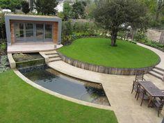 view down to oak retaining wall in modern garden near Cheltenham