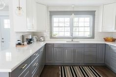 This is what I want our kitchen to look like.  Except I would change the white upper cabinets to gray.  The backsplash would be white subway tile, countertops and trim would also be white.