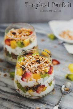 Tropical Parfait - consists of layers of coconut yogurt, Coconut Cardamom Granolaand some tropical fruits like pineapple, mango, kiwi, strawberries.