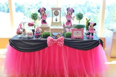 Minnie Mouse Party. I LOVE the table tutu and black with the bow!