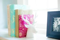 Not every book is worthy of display on your smartly styled bookshelf. Wrap those not-so-cute (or guilty pleasure) hardcovers in vibrant papers for a bit of colorful eye candy.