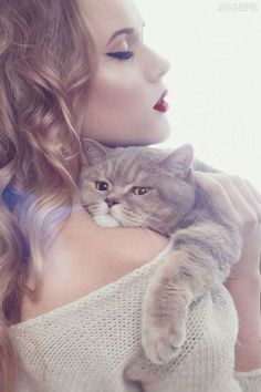 "She is gorgeous but the disgruntled kitty just totally takes all the elegance of this photo away. ""Uuuhhnfff"" Hahaha."