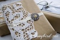 vintage inspired gift wrap.  Doily with ribbon and broach over craft paper wrapping.