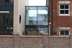 IQ Glass renovated this medical centre in Stevenage, Hertfordshire by adding a glass extension that also works as a glass link between the two buildings.