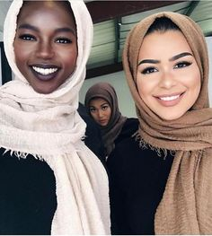 The woman on the right created the line of hijabs that the women in the picture are wearing. She is an example of an influential Muslim woman.