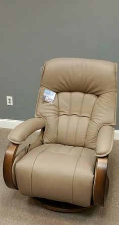 Himolla Mosel Recliner. The adjustable headrest and back support that allows you to recline in the most comfortable angle. The mechanism is super simple. All you do is push back, pull the leather handle and lay as far back as you'd like!